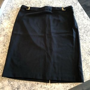 New York & Company black skirt with gold buckles